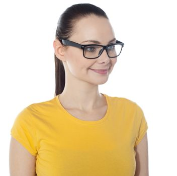 Beautiful young smiling woman in glasses, on white background