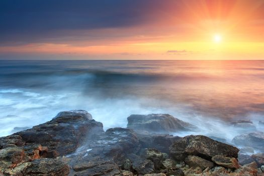 Beautiful rocky coastline at the sunset