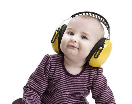 baby with yellow ear protection in loud environment. Isolated on white background