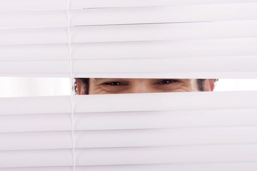 hands apart on the window blinds