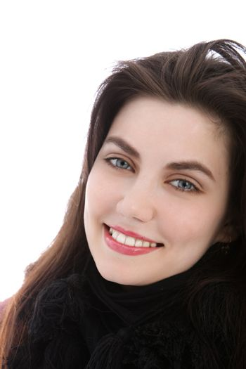 Blue eyed happy young woman looking at camera