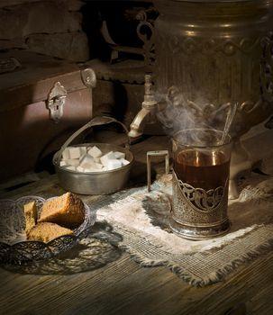Old samovar on the table with tea