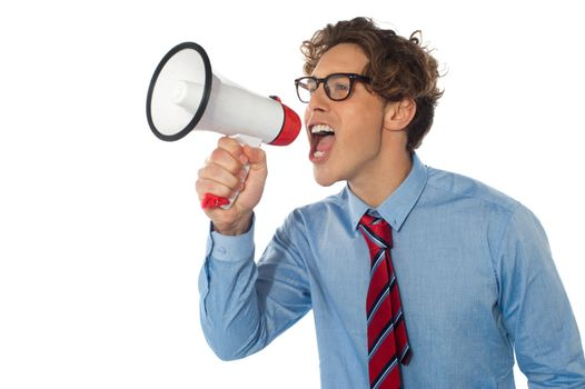 Young businessman using megaphone isolated over white background