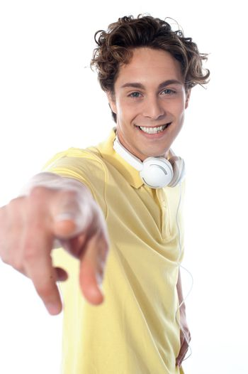 Guy with headphones pointing at you