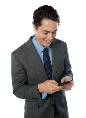 Portrait of a Happy businessman using a mobile phone