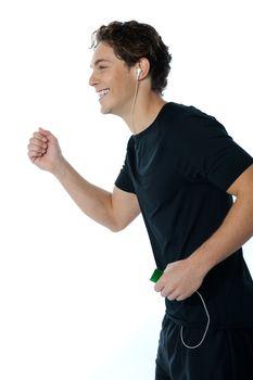 Handsome sports person enjoying music