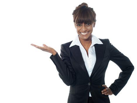 Female executive exposing copyspace area
