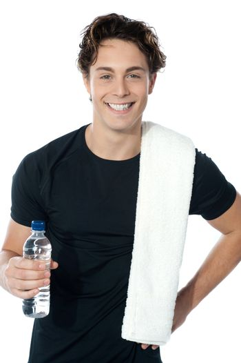 Handsome muscular man with towel