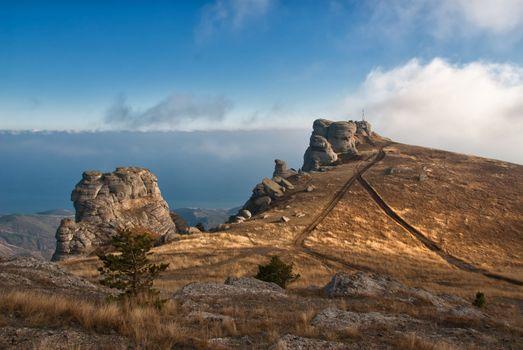 Rocks in mountains among clouds, Crimea, Southern Demerdzhi