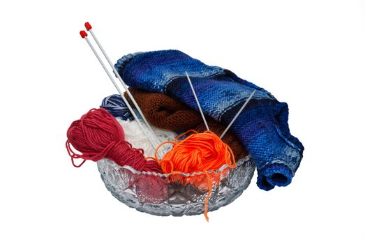 Balls of wool and knitting needles in vase isolated on a white background