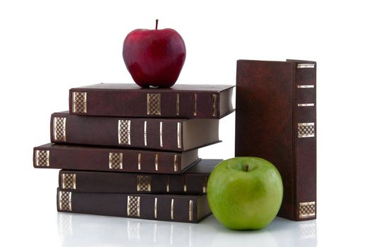 The tower of the books with apples, isolated on white background