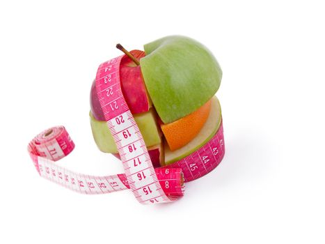 Fruit mix with tape measure, isolated on white
