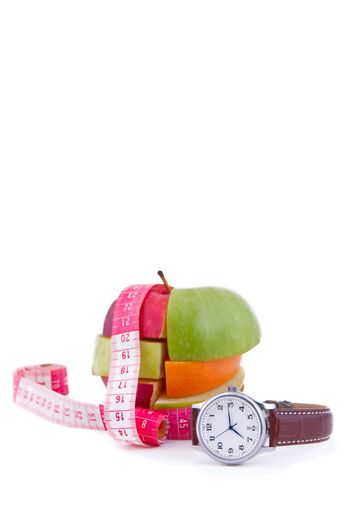 Fruit mix with tape measure and watch, isolated on white