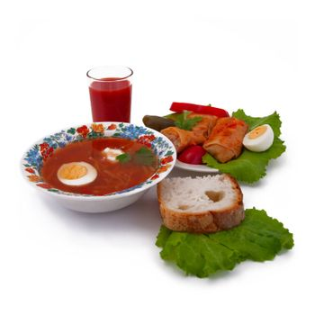 Borscht, stuffed cabbage, tomato juice and bread isoleted on white