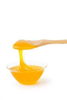 Golden fresh honey, isolated on white background