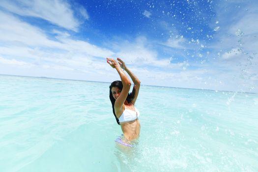Woman splashing in sea