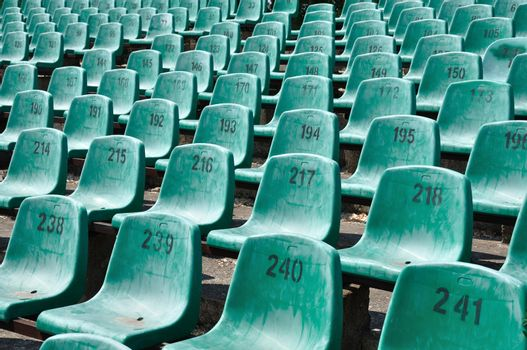 Green numbered seats at a stadium