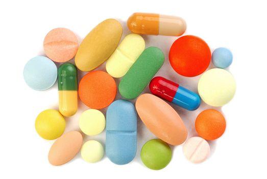 Macro of pills on white background