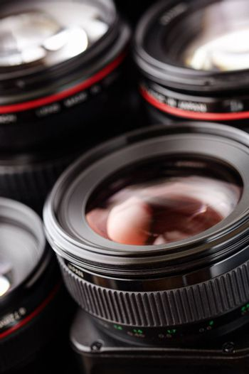 many lens in closeup, selective focus on nearest part