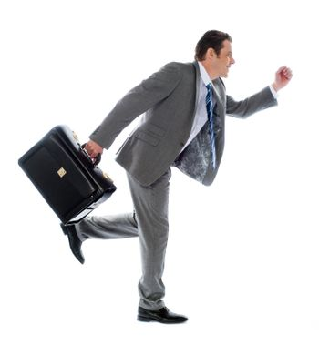 Businessman running with a briefcase