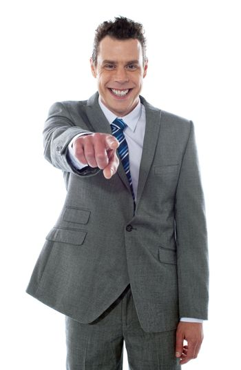 Portrait of businessman pointing at you isolated over white background