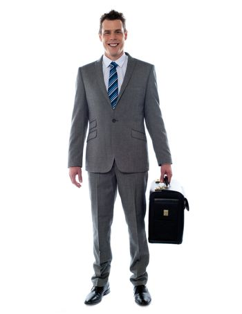 Business executive holding briefcase looking at you