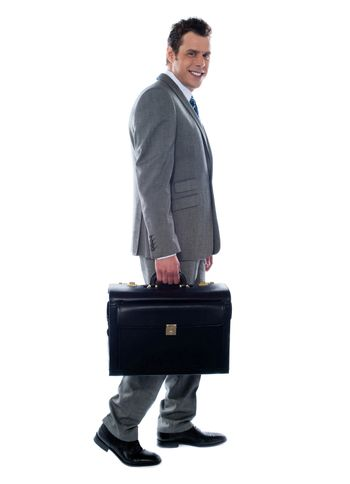 Going business man holding briefcase over white
