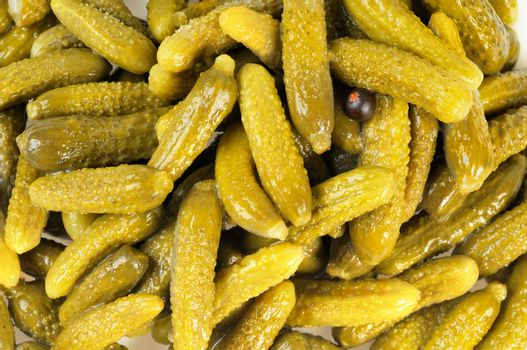 Lot of pickles.  Cucumbers on background.  Gherkins.