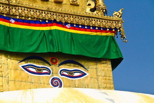Buddha eyes on stupa of the swayambhunath temple with blue sky i