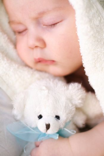 Baby sleeps with a toy