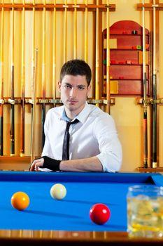Billiard expertise man posing on blue
