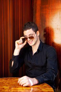 Latin mediterranean handsome man with sunglasses