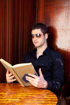 Latin tourist man reading a map book