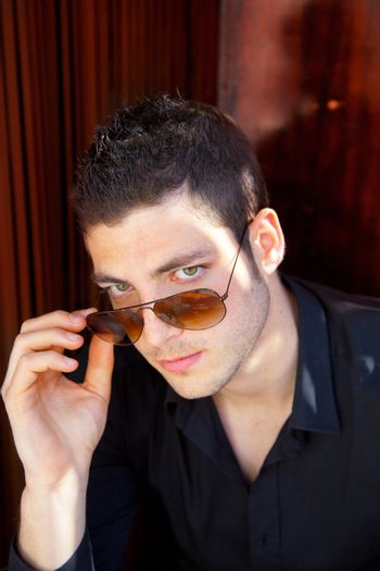 Handsome young man portrait with sunglasses