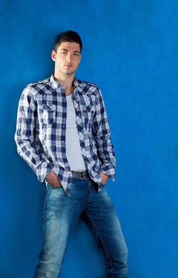 handsome young man with plaid shirt denim jeans in blue