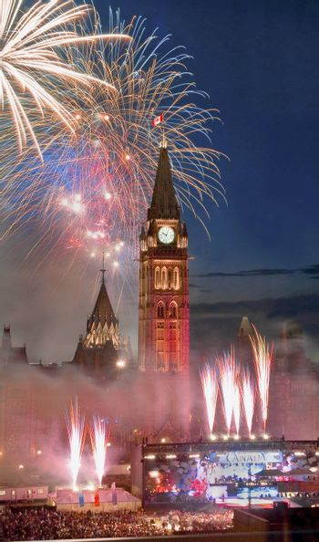 The canadian Parliament during the fireworks display on Canada Day in July.