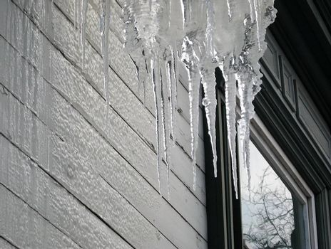 Icicles near the window in winter