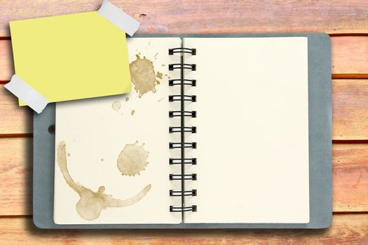 blank white notebook on rubber wood background