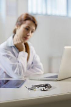 stethoscope on desk in doctor office