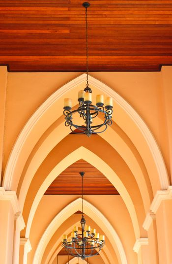 arched ceiling of church with chandelier