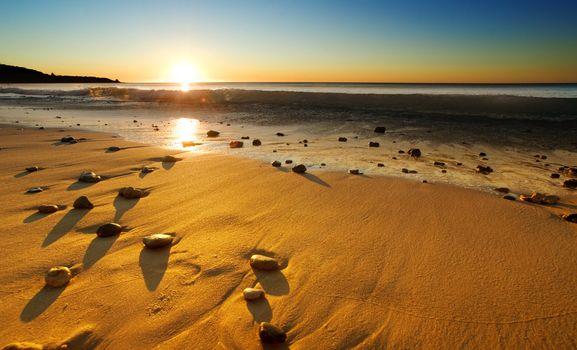 The sun sets over a beautiful Australian beach