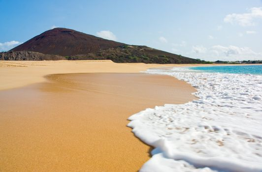 Water laps onto Long Beach, Ascension Island