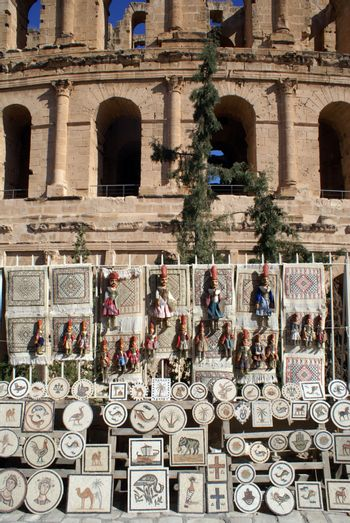 Souvenirs and wall of roman theater in El-Jem, Tunisia