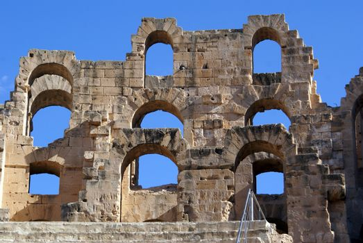 Wall of roman theater and blue sky in El-Jem, Tunisia