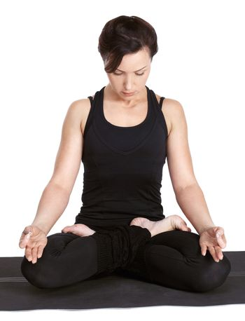 full-length portrait of beautiful woman working out yoga exercise padmasana (lotus pose) on fitness mat