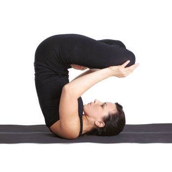 full-length portrait of beautiful woman working out yoga exercises urdhva padmasana pose on fitness mat