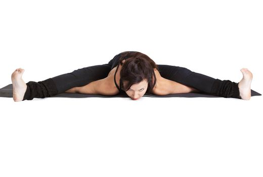 full-length portrait of beautiful woman doing the splits on fitness mat