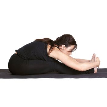 full-length portrait of beautiful woman working out yoga exercises on fitness mat