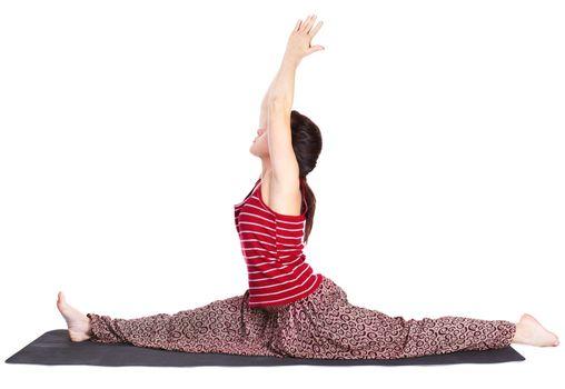 full-length portrait of beautiful woman doing the yoga splits hanumanasana (monkey pose) on fitness mat