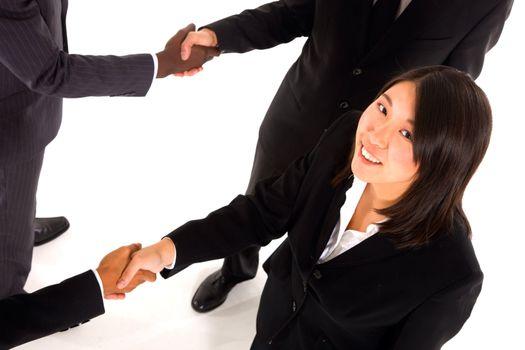 working team shaking hands